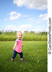 Cute Baby Toddler Girl Runing OUtside in the Grass on a Summer Day