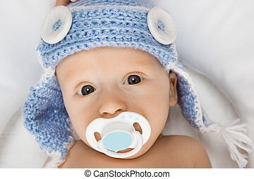 Cute baby with a pacifier.
