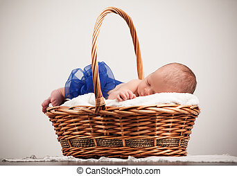 Cute baby with bow taking nap.