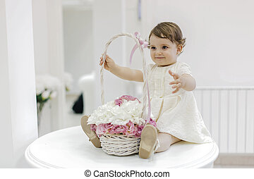 Cute baby with flower basket