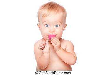 Cute baby with food spoon in mouth