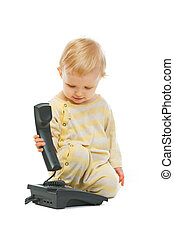 Cute baby with phone on white background