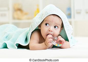Cute baby with teether under towel indoor - Cute baby boy...