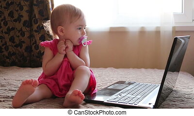 Cute baby working on computer