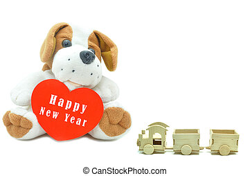 Cute beagle puppy doll showing red heart Happy New Year 2017 with wooden train toy.