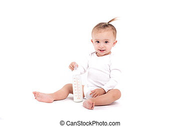 cute beautiful baby girl in white shirt sit and hold milk bottle