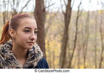 Cute beautiful pretty redhead female teenager in autumn...