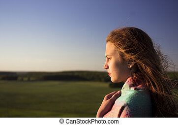 beautifull teenage girl looking into the distance