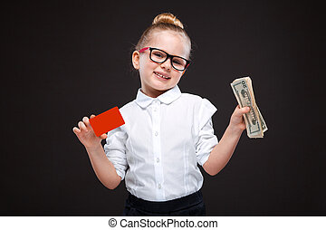 Cute beauty young girl in white shirt and black trousers hold red card and cash