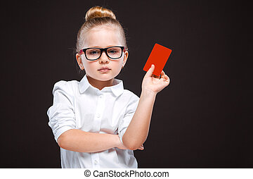 Cute beauty young girl in white shirt and black trousers hold red card