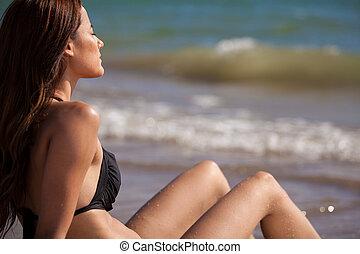 Cute bikini girl getting a suntan
