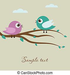Cute birds on the tree branch