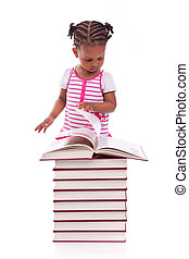 Cute black african american little girl reading a book, isolated on white background - African people - Children