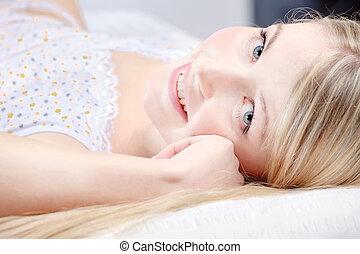 Cute blond girl on pillow