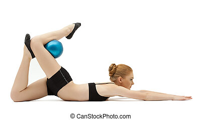 cute blond girl training with blue ball isolated