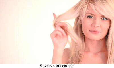 Cute blond-haired woman posing