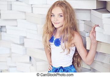 Cute blond teenager female in a blue skirt.