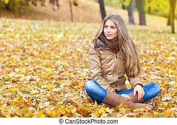 Cute blond woman in autumn