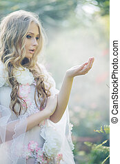 Cute blond woman in the tropical garden - Cute blond lady in...