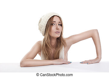 Cute blond woman in white cap look at you