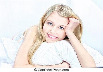 blond woman on pillow
