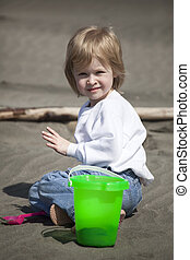 Cute Blonde Child Playing at the Beach - Cute blonde child...