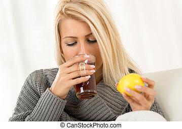 Cute Blonde Girl Drinking Tea