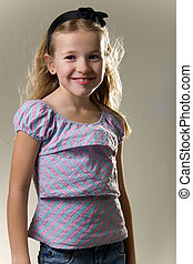 eight year old - cute blonde little eight year old girl in...