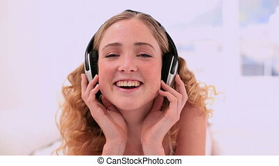 Cute blonde model enjoying music