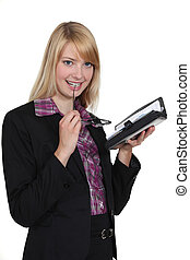cute blonde secretary with agenda sucking on her glasses