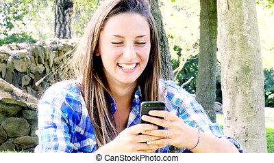 blonde teenager taking selfie