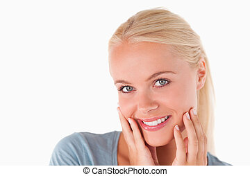 Cute blonde woman smiling at the camera