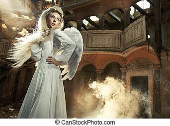 Cute blondie as an angel posing