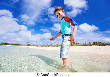 Cute boy at beach