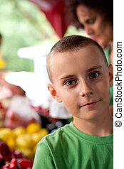 Cute boy at the farmer's market