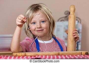 Cute boy baking ginger bread cookies