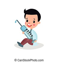 Cute boy doctor in professional clothing sitting on the floor and holding giant syringe, kid playing doctor vector illustration