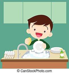 cute boy doing dishes.Teenage washing dishes.