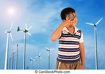 cute boy exploring nature with magnifying glass