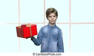Cute boy holding box with present.