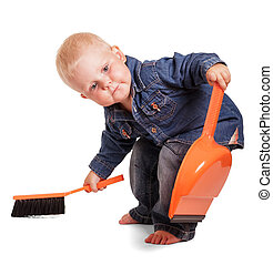 Cute boy holding dustpan having bent and sweeping brush isolated.