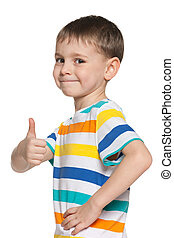 Cute boy holds his thumb up