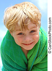 Cute Boy in Beach Towel - A cute, laughing toddler wrapped...