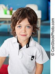 Cute Boy In Casuals At Kindergarten - Portrait of cute...