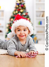 Cute boy in front of Christmas tree
