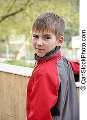 cute boy in red jacket