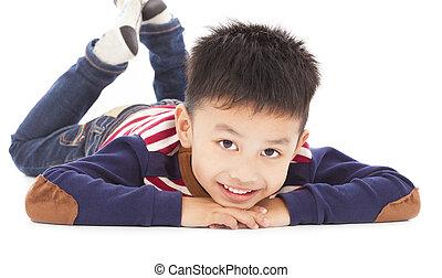 cute boy is lying on the floor