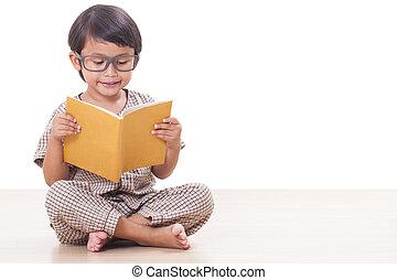 Cute boy is reading a book