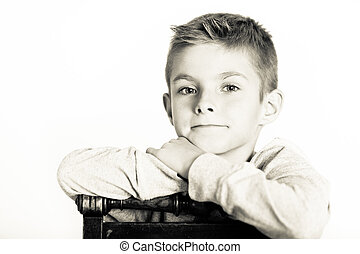 Cute Boy Leaning on a Chair in Monochrome Color