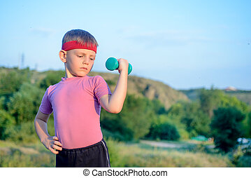 Cute Boy Lifting Dumbbell with Right Hand on Waist